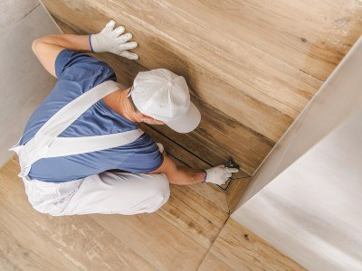You should first seal the vertical tile surfaces such as backsplashes and shower walls.